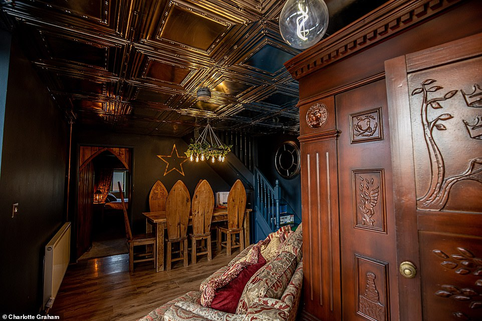 The Dorm accommodation has a luxurious, gothic and Harry Potter-inspired dining room that sits six. There is oak panelling and deep blue walls.