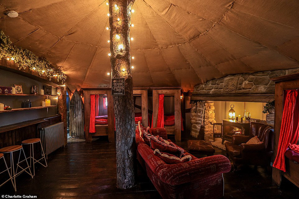 The Dorm holiday home has a spacious, dim living area surrounded by four-poster beds very like in te Gryffindor dormitories.