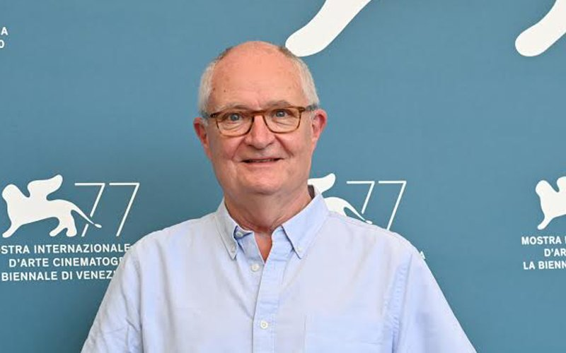 Jim Broadbent smiles from a press conference at the Venice Film Festival.