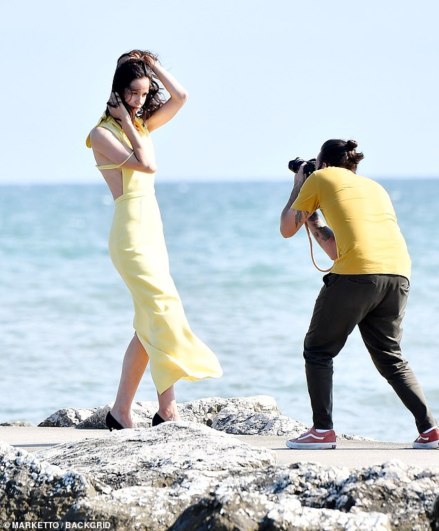 Katherine Waterston poses for a windswept photo on the beach at the Venice Film Festival.