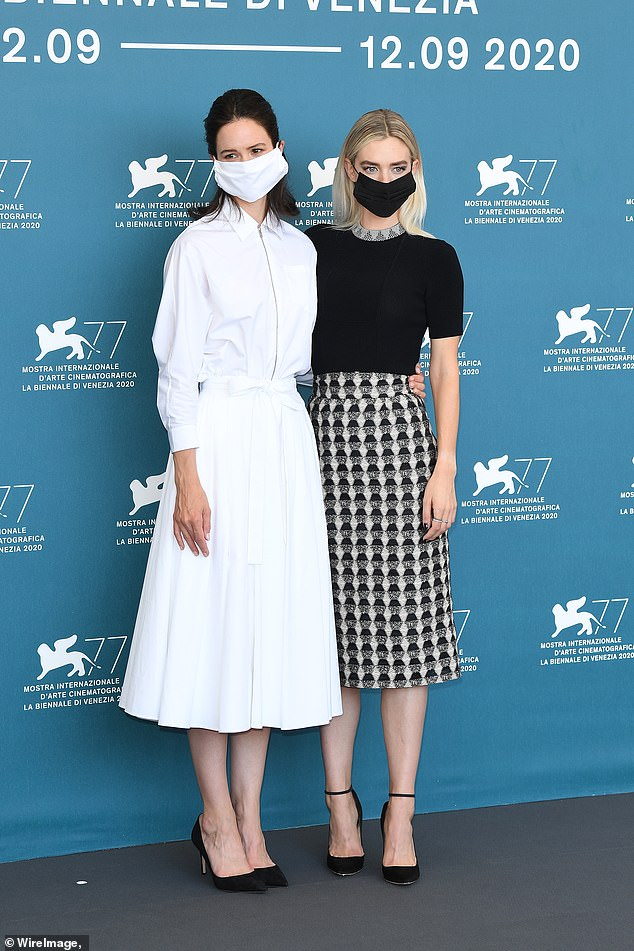 """All masked up, Katherine Waterston poses with """"The World to Come"""" costar Vanessa Kirby at the Venice Film Festival."""