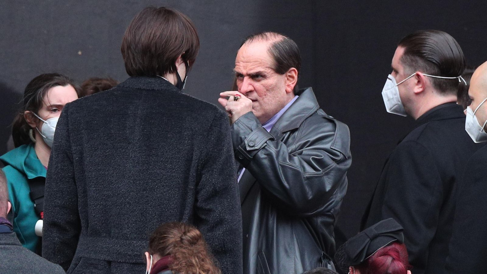 """Colin Farrell takes a drag off a stogie as Oswald Cobblepot during filming for """"The Batman""""."""