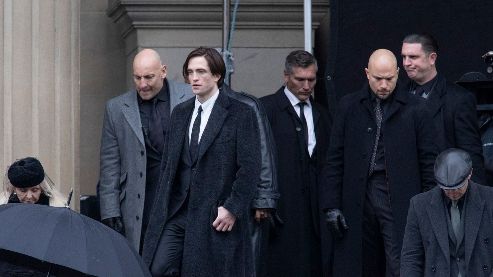 """Robert Pattinson is pictured as Bruce Wayne during what appeared to be the shooting of a funeral scene for """"The Batman""""."""