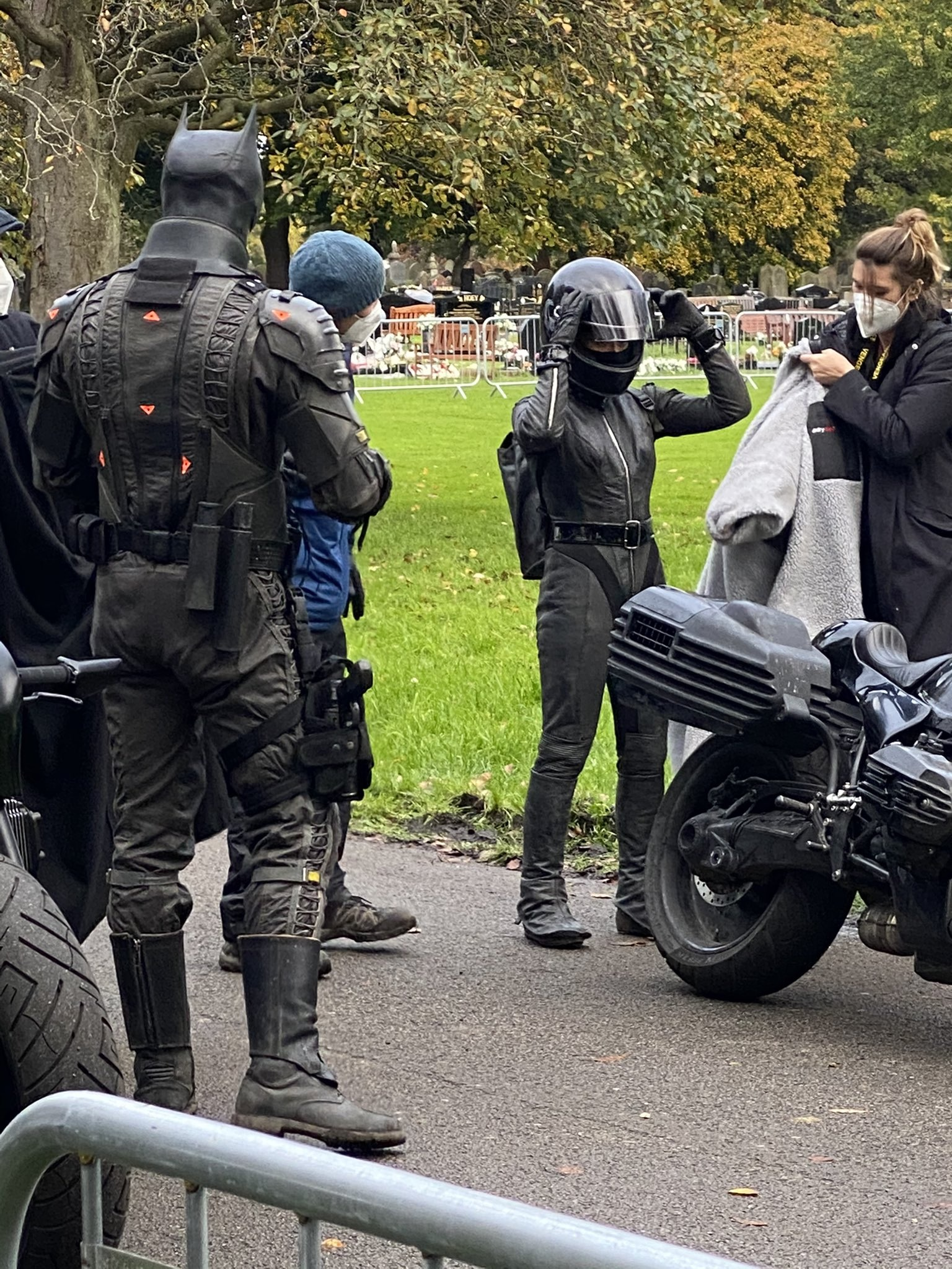 "Zoë Kravitz's stunt double prepares to board her bike during filming for ""The Batman""."