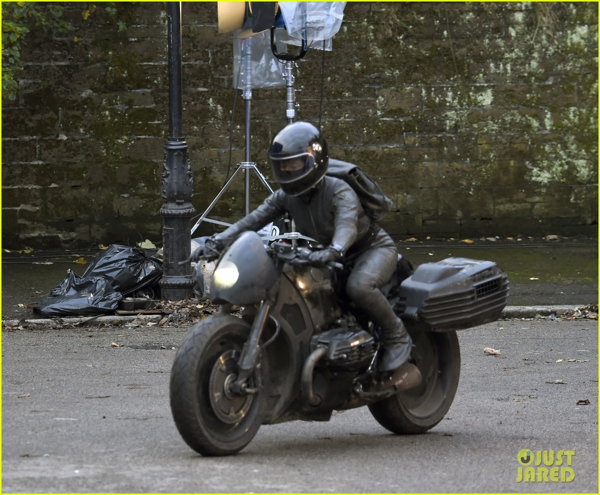 """Zoë Kravitz's stunt double flees aboard a motorcycle during filming for """"The Batman""""."""