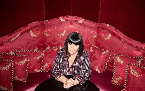"Dawn French is pictured, seated on a red coach, during an interview with the ""Telegraph""."
