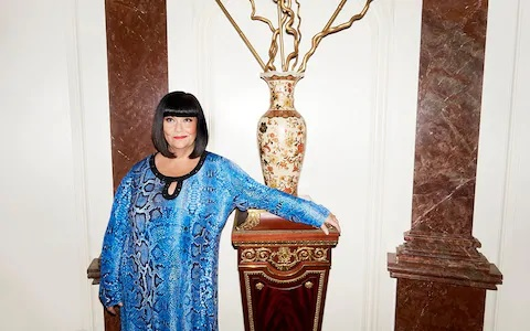 "Dawn French is pictured, standing alongside a vase on a table, for an interview with the ""Telegraph""."