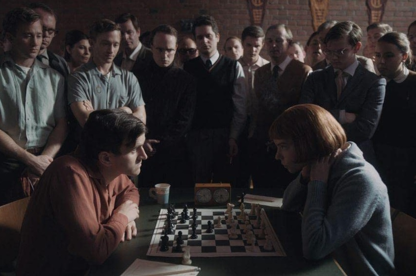 """Harry Melling takes on Anya Taylor-Joy in a game of chess in this still from """"The Queen's Gambit""""."""