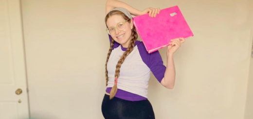 Jessie Cave holding her recently submitted novel.