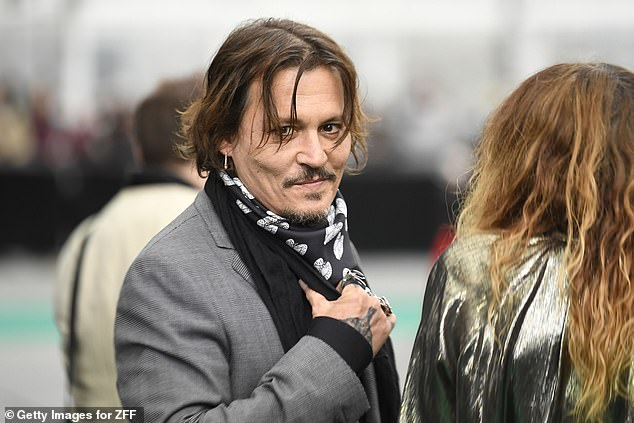 Johnny Depp makes his way along the red carpet at the Zurich Film Festival.