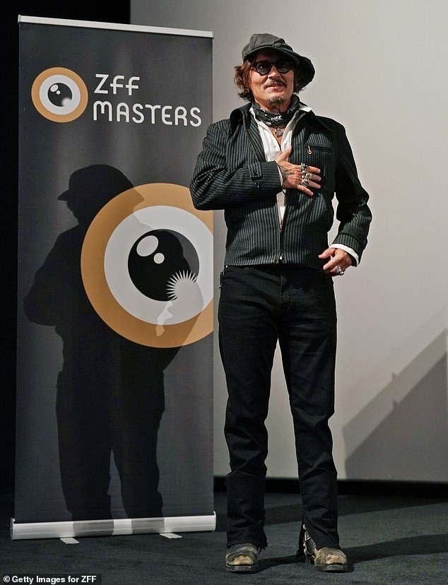 Johnny Depp poses for a photo at the Zurich Film Festival.