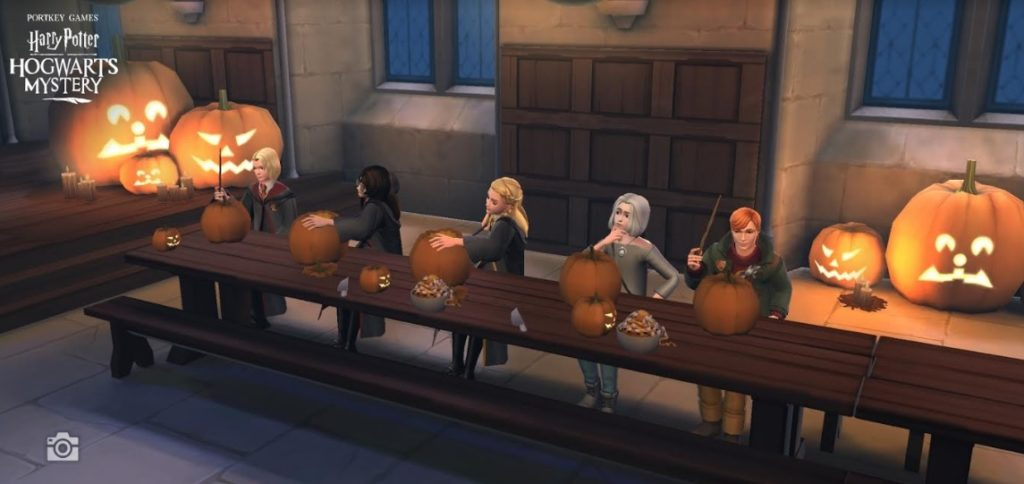 "Characters from ""Hogwarts Mystery"" carve pumpkins in the Great Hall."