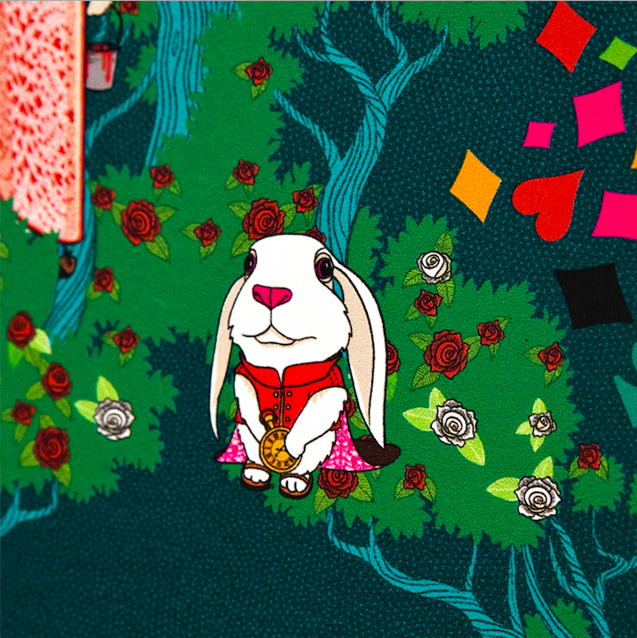 This zoomed-in portion of the wallpaper shows the White Rabbit holding his gold watch in front of a white and red rose bush.