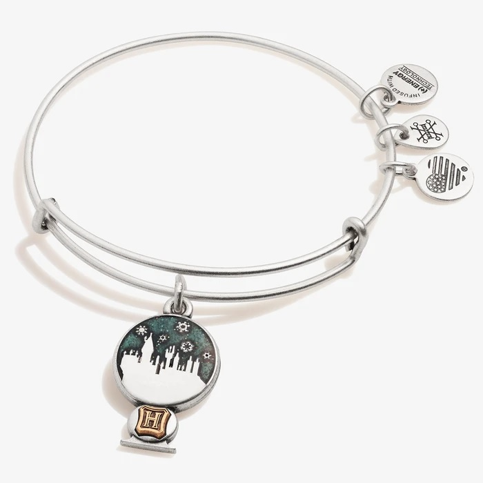 Pictured is a snowy Hogwarts inside a snow globe on a bangle bracelet from Alex and Ani.