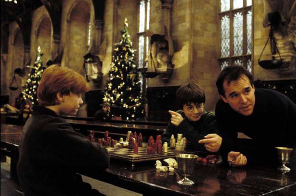 Chris Columbus is directing Daniel Radcliffe Rupert Grint in the wizards chess scene in Harry Potter and the Sorcerer's Stone.