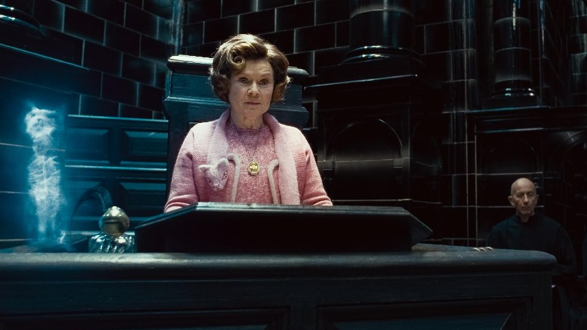 Dolores Umbridge is scary as she reigns from her pedestal in the Ministry of Magic, pritected by her patronus cat.