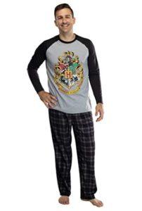grey men's pajamas with Hogwarts crest are modeled