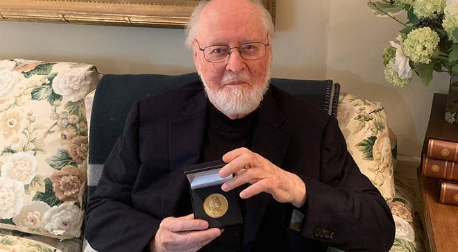 John Williams poses for a photo with his RPS Gold Medal.