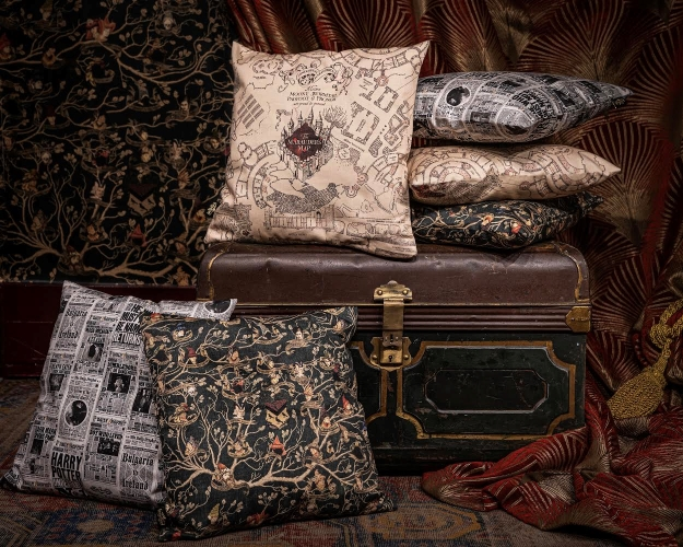 The cushion covers from the MinaLima collection are shown on cushions in a posed photograph.