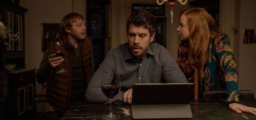 "In a still from Season 2 of ""Servant"", Rupert Grint (who plays Julian Pearce) waves a wine glass in mid-discussion with Toby Kebbel (who plays Sean Turner) and Lauren Ambrose (who plays Dorothy Turner)."