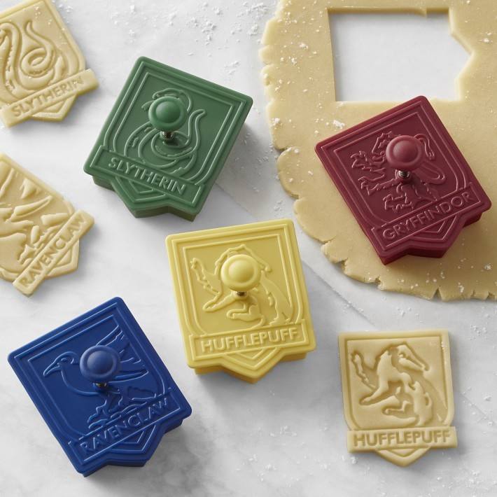 Pictured is a set of Hogwarts House-themed cookie cutters from Williams Sonoma.