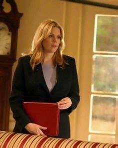 Kate Harper holding a red folder