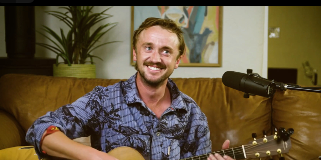 Tom Felton playing and singing at his home party.