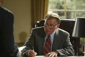 Jed Bartlet sitting at a desk