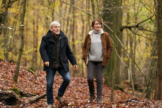 "Fiona Shaw walks through the woods with her ""Baptiste"" costar in a still image from Season 2."