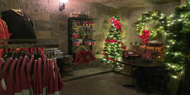 The Gryffindor corner of  Filch's Emporium of Confiscated Goods features memorabilia and Christmas decorations.