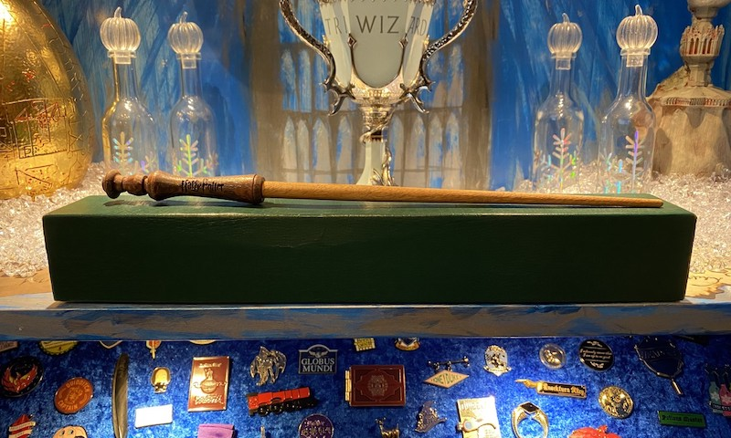 Besides wands, Maclean's collection contains plushies, books, pins, badges, and props.