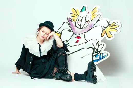 "Helena Bonham Carter sits alongside an illustration from ""Clown."""