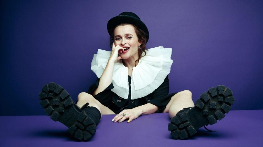 "Helena Bonham Carter clowns around in a ruffled collar and bowler hat in a photo shoot for ""Clown."""