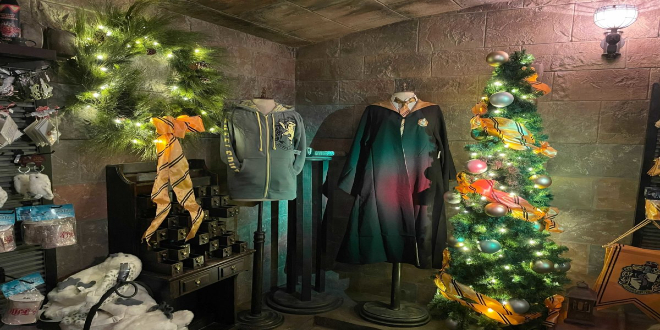 Hufflepuff's corner contains Hufflepuff robes, as well as trees and wreaths draped in yellow ribbon.