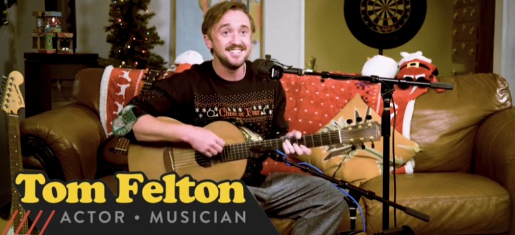 Felton shows off his musical skills for his Holiday Home Party.
