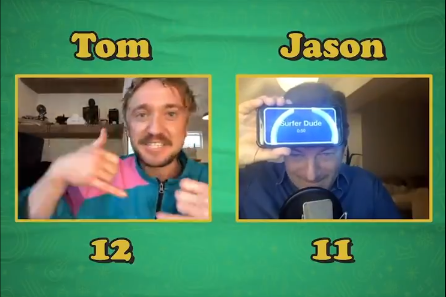 """Tom Felton performs a killer surfer dude impression as a clue for Jason Isaacs while playing """"Heads Up!"""""""