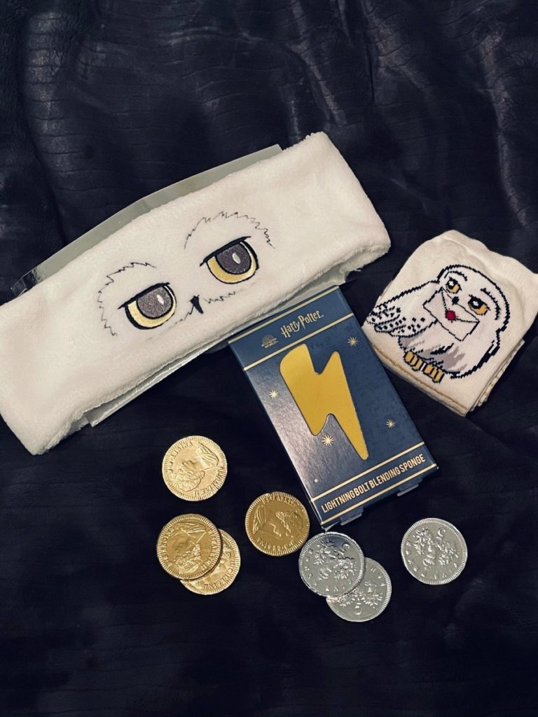 Some of the gifts from the calendar were a Hedwig headband, Hedwig socks, and some chocolate coins.