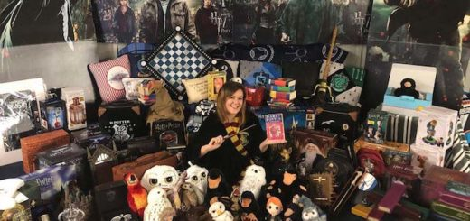Victoria Maclean sits on the floor surrounded by her Wizarding World merchandise collection.