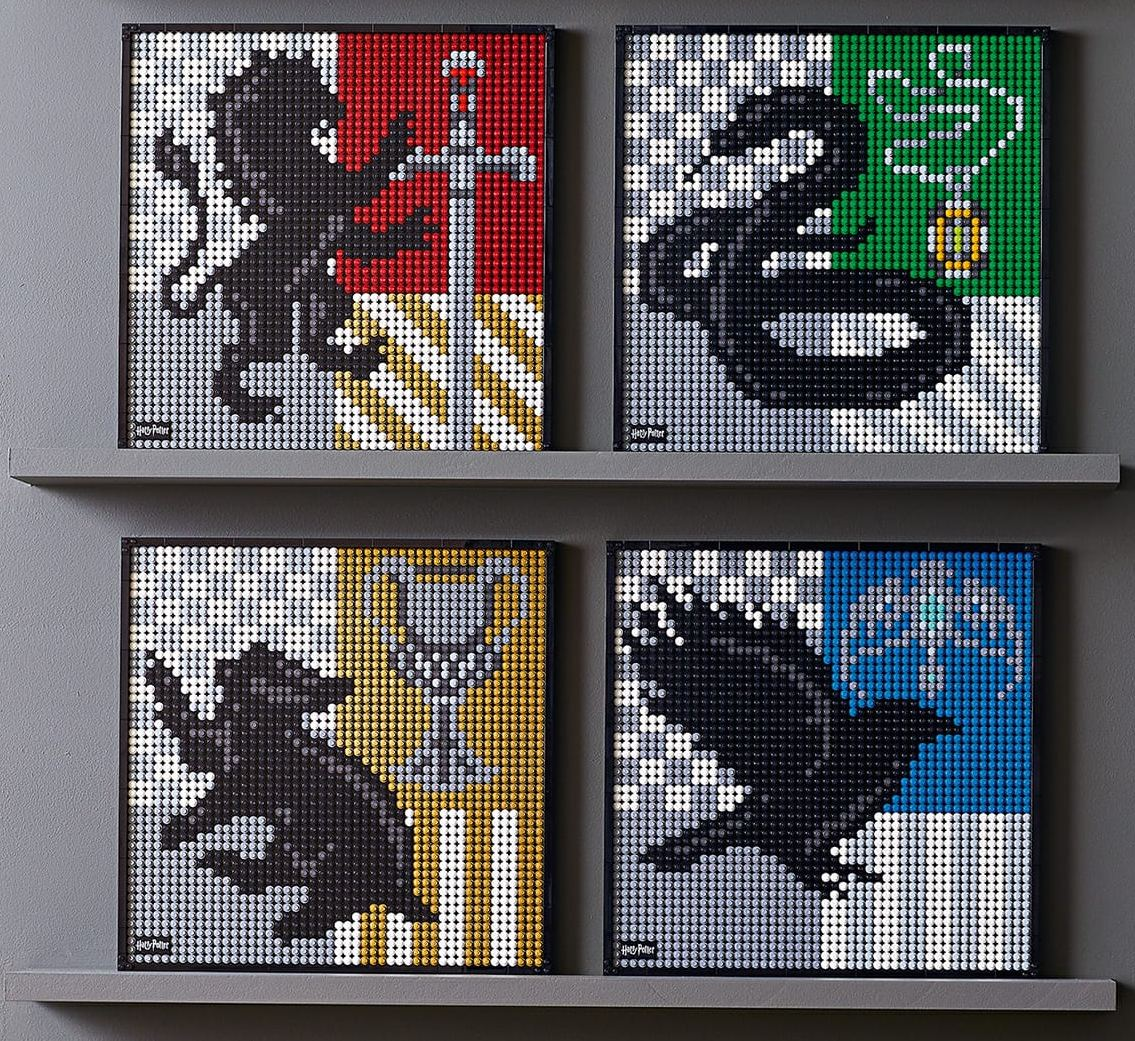Four completed versions of the Harry Potter Hogwarts Crests LEGO wall art set are displayed on two shelves.