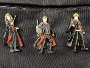 FiGPiN® Harry Potter Wave Package clipped onto bag