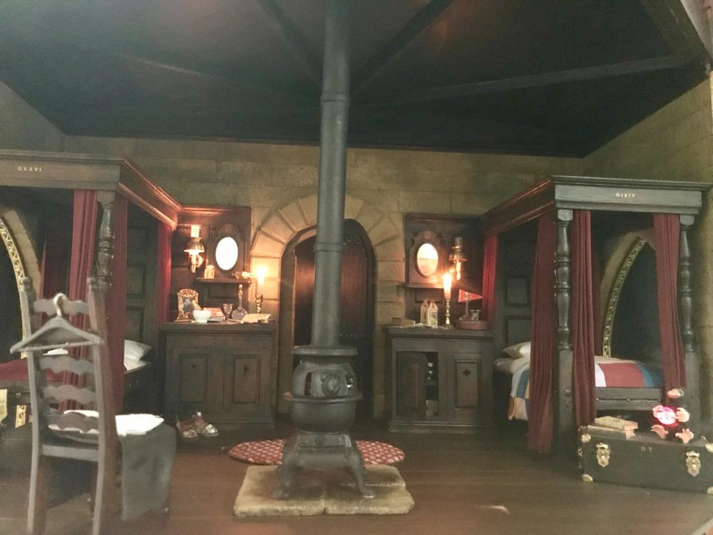 The Gryffindor Common room shows the beds of two students with all their personal effects.
