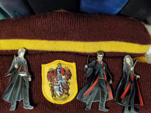 "FiGPiN® ""Harry Potter"" enamel pins clipped onto a hat"