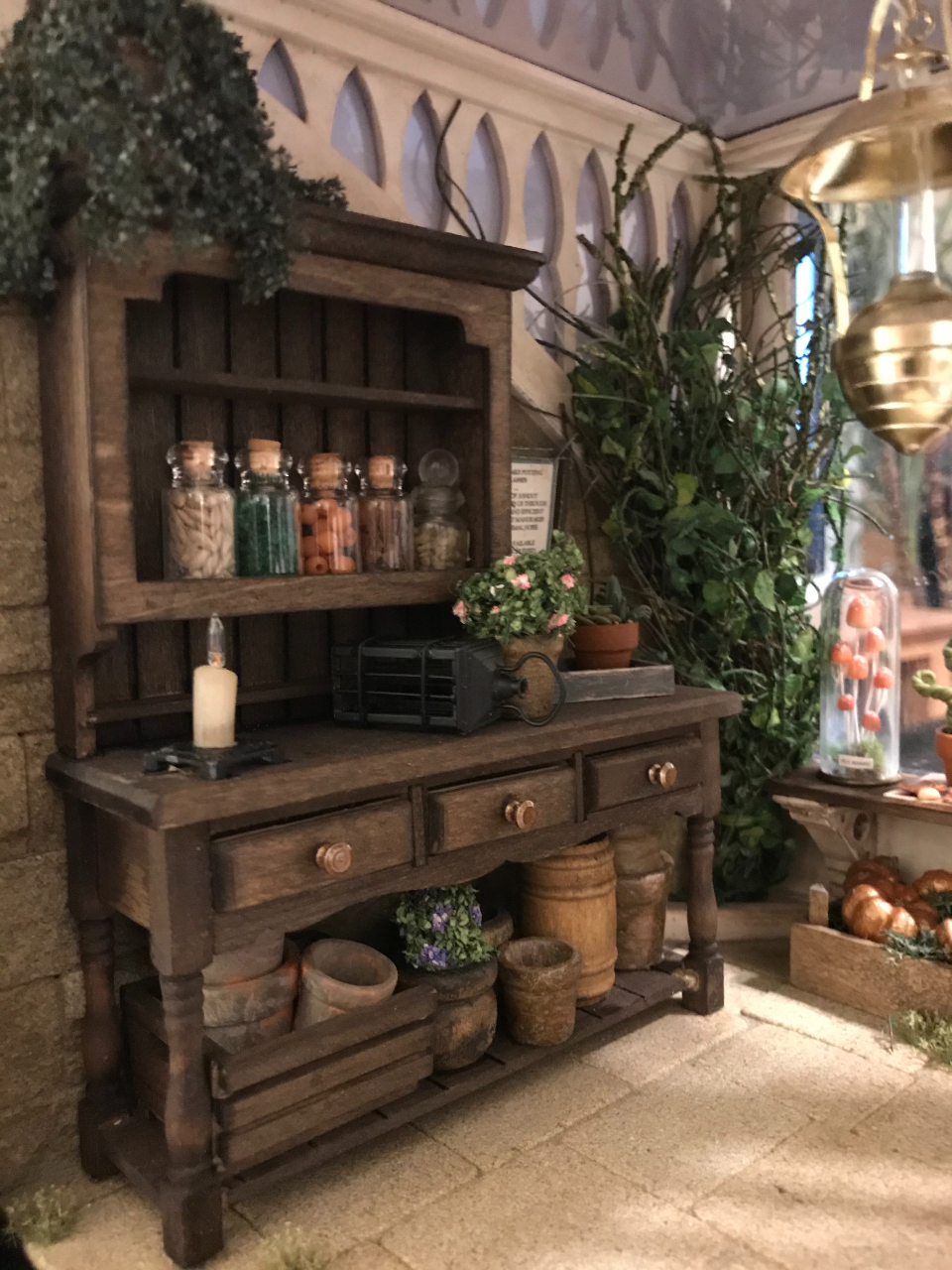 The herbology room includes a variety of plants and mini jars filled with a selection of seeds.