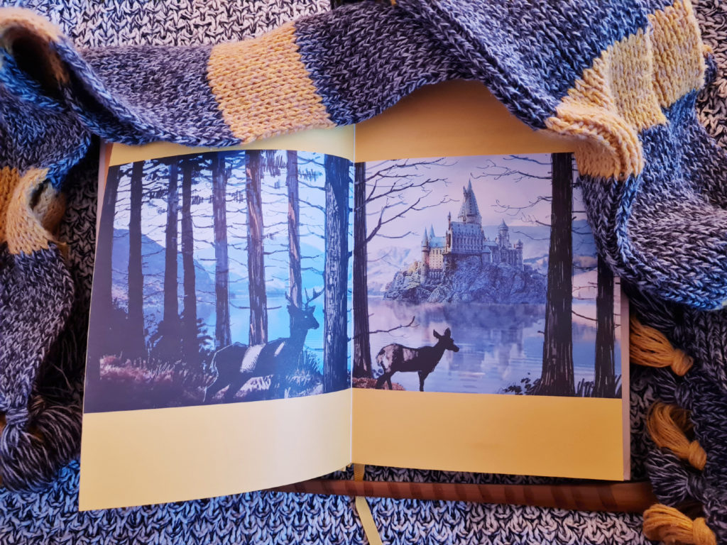 """""""Harry Potter"""" film concept art of the view of Hogwarts across the Black Lake with trees and deer featured in """"Loyalty: A Guided Journal for Embracing Your Inner Hufflepuff"""" from Insight Editions"""