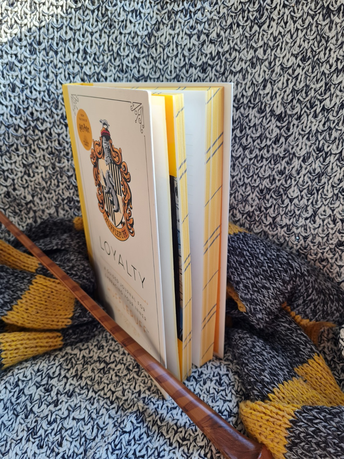 """Striped page edges of """"Loyalty: A Guided Journal for Embracing Your Inner Hufflepuff"""" from Insight Editions"""