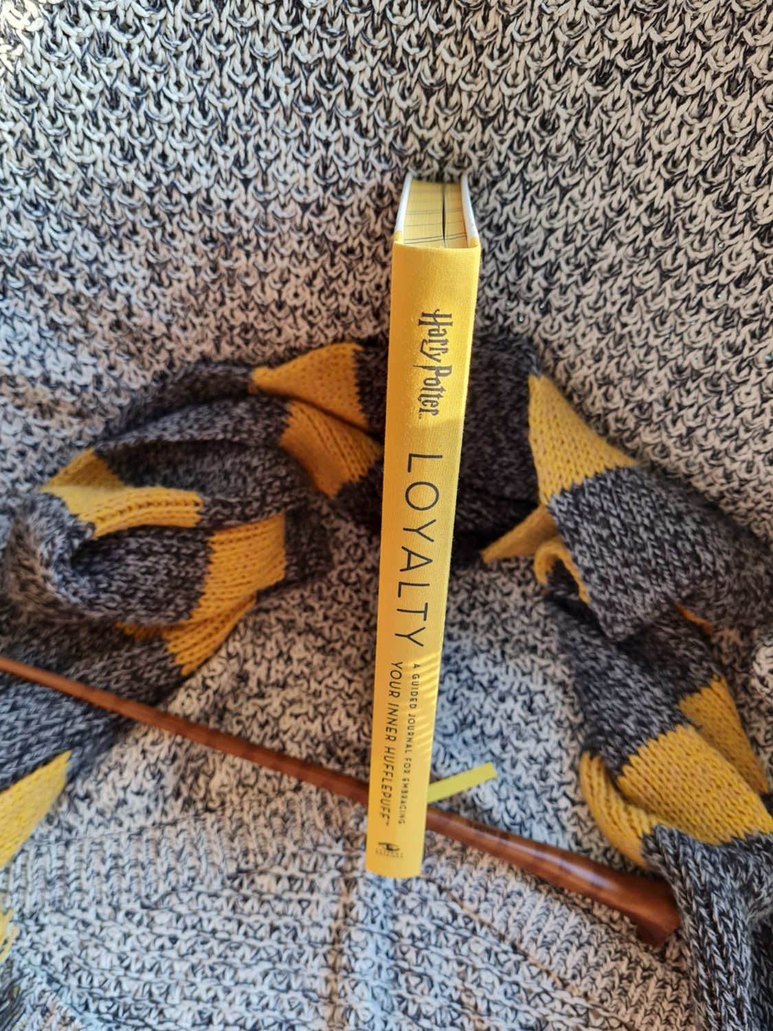 """Clothbound spine of """"Loyalty: A Guided Journal for Embracing Your Inner Hufflepuff"""" from Insight Editions"""