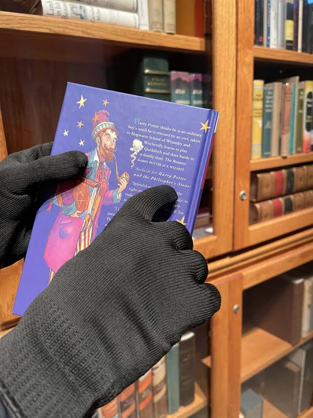 """The back cover of Jeremy Padawer's copy of """"Harry Potter and the Philosopher's Stone"""" is shown."""
