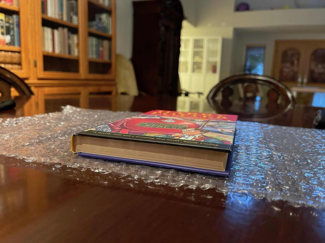 """The binding of Jeremy Padawer's copy of """"Harry Potter and the Philosopher's Stone"""" is shown."""