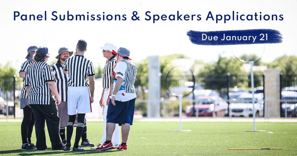 """There are six referees discussing something on the right. Above their heads, there is a blue sign """"Panel Sumbissions & Speaker applications"""" and white sign """"Due January 21"""" on a blue background below it."""