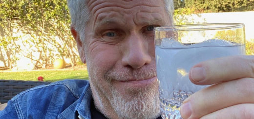 Ron Perlman raising his glass to 2021.